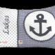Namenskissen mit Anker in dunkelblau mit Stickerei und passender Zackenlitze