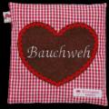 """Waermekissen in rot mit Herz-Applikation und Stickerei """"Bauchweh"""""""