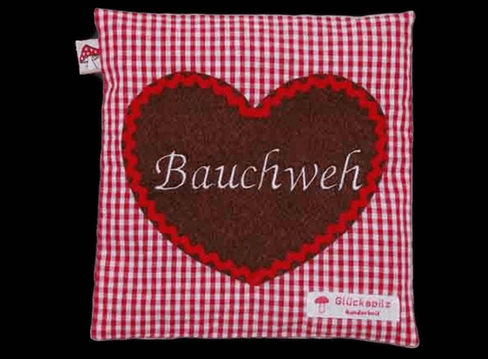 """Rotes Kissen mit Herz-Applikation und Stickerei """"Bauchweh"""""""
