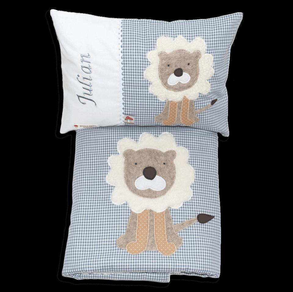 Kissen und Decke mit Löwen-Applikation und Namensstickerei in grau