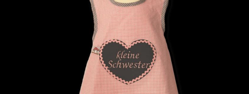 Schickes Schürzenkleid kleine Schwester in rosa mit Lebkuchenherz-Applikation und Vichykaro-Details